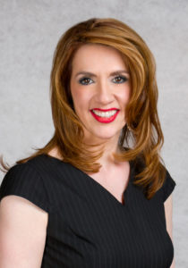 image of Magdalena Verdugo in a black blouse facing the camera and smiling